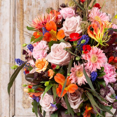 Rich flower arrangement in floral foam
