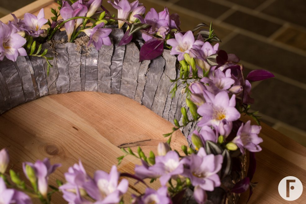 Funeral flower wreath with purple freesia