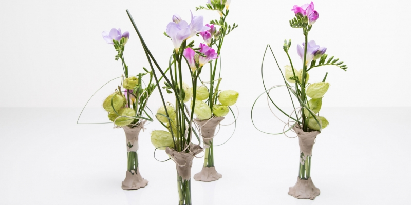 Clay vases with purple Freesias